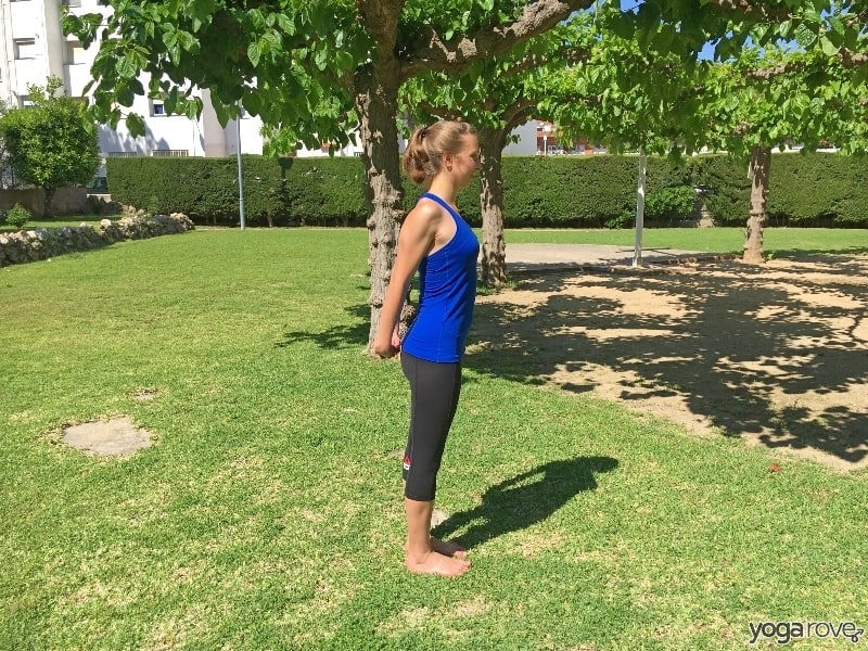 yoga poses- hand clasp behind back to gently stretch the shoulders