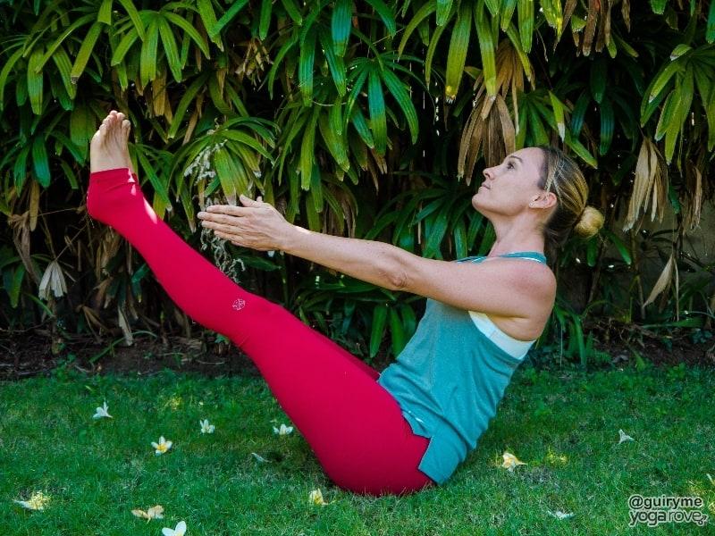 yogi practicing boat pose.