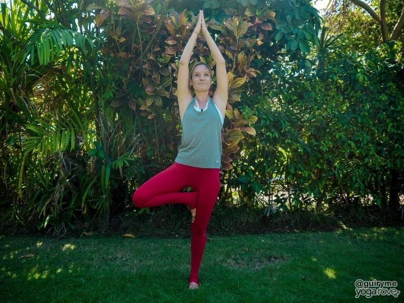 yogi practicing beginner balancing yoga pose- tree pose