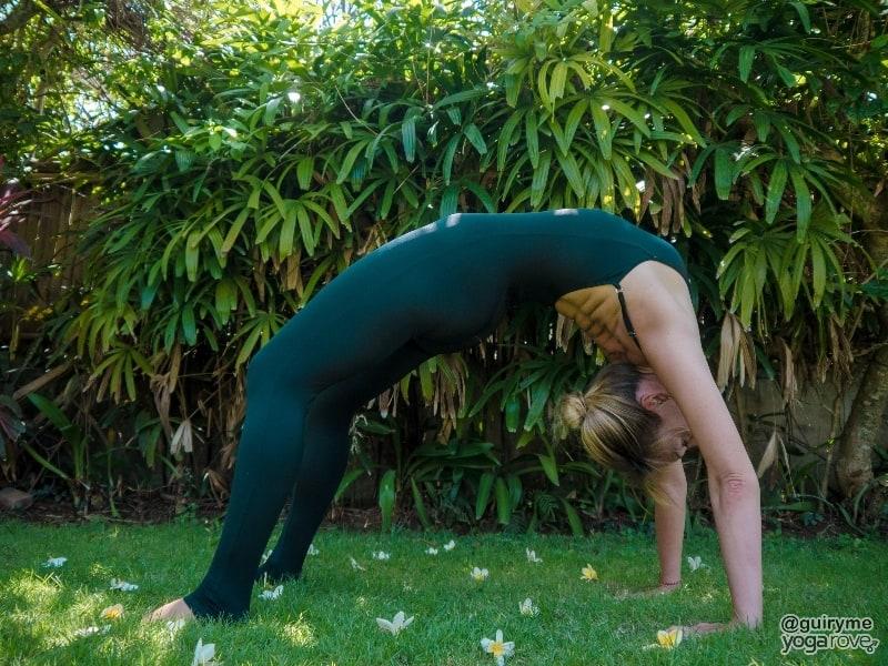 yogi practicing wheel pose to improve posture