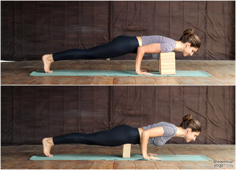 yogi practicing chaturanga  with block under shoulders and block under hips.