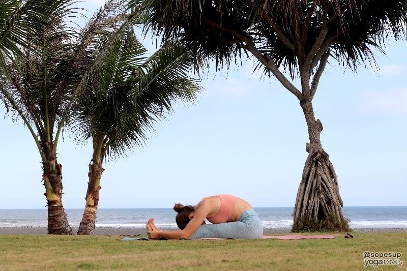 yogi practicing seated fold post run.