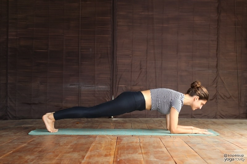 beginner yogi practicing forearm plank for chaturanga prep