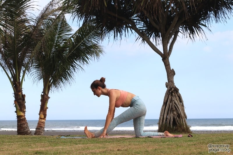 yogi practicing half split after running.