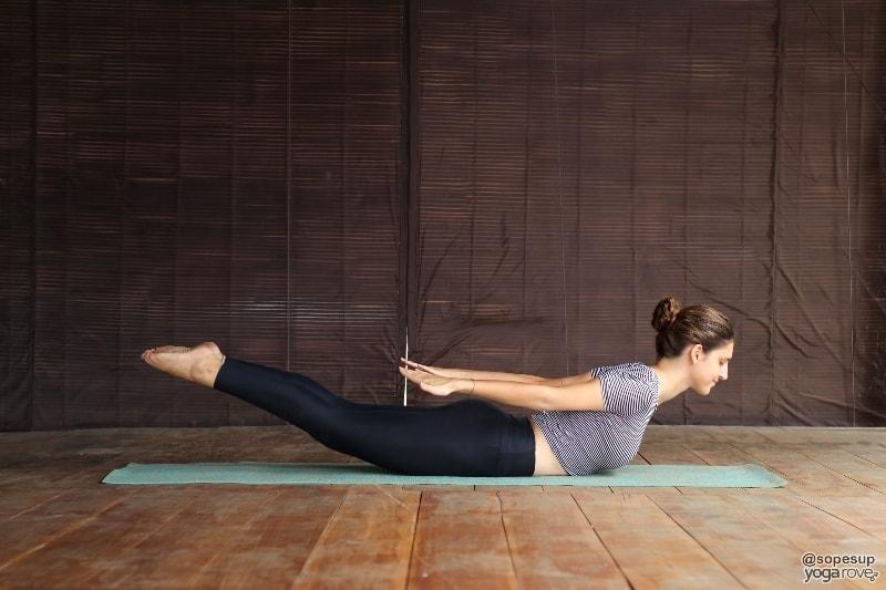yogi practicing locust for chaturanga prep