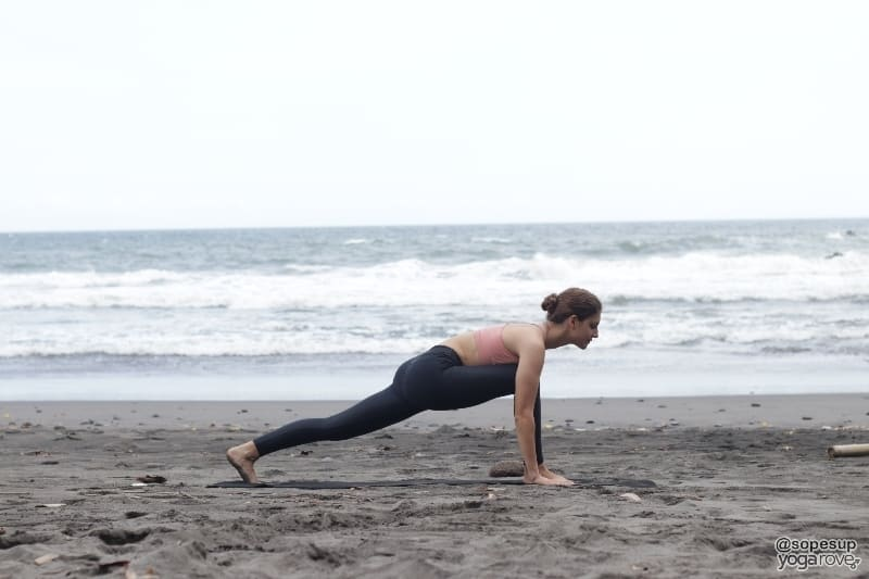 yogi practicing sun salutation a- low lunge