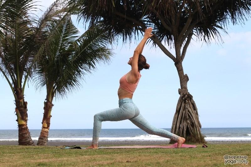 yogi practicing high lunge after running
