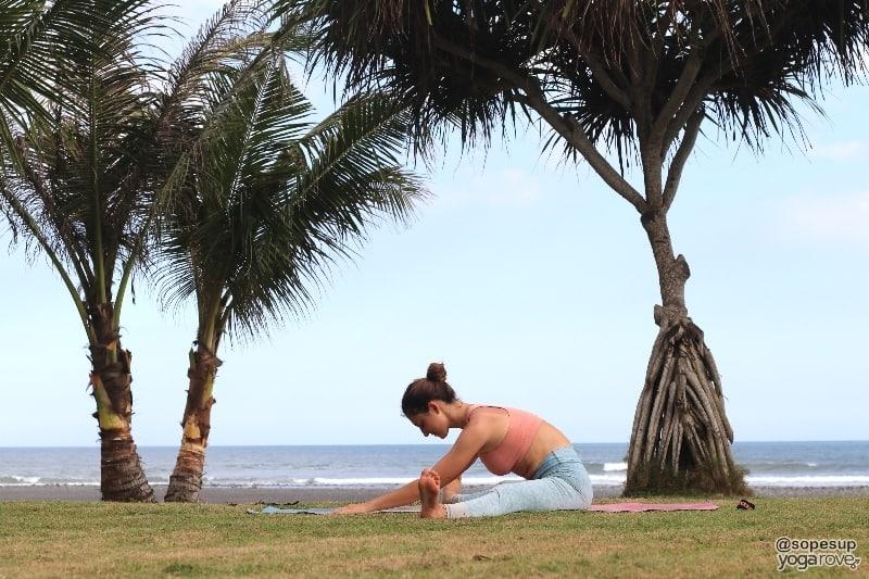 yogi practicing wide legged fold post run.