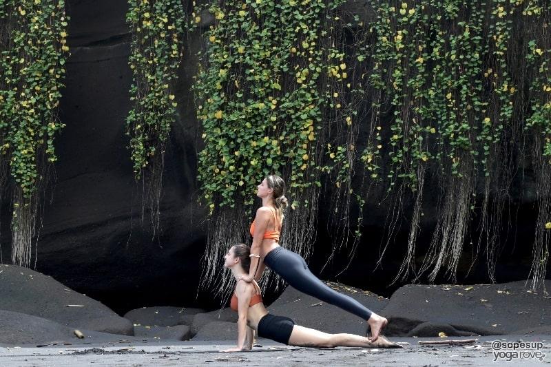 two yoga students practicing double upward facing dog- partner yoga.