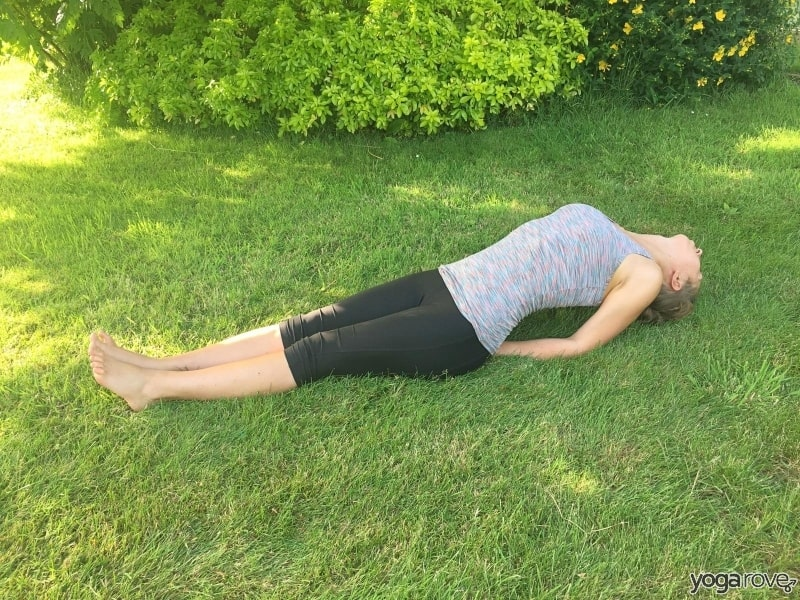 yoga student practicing fish pose for pain between shoulder blades
