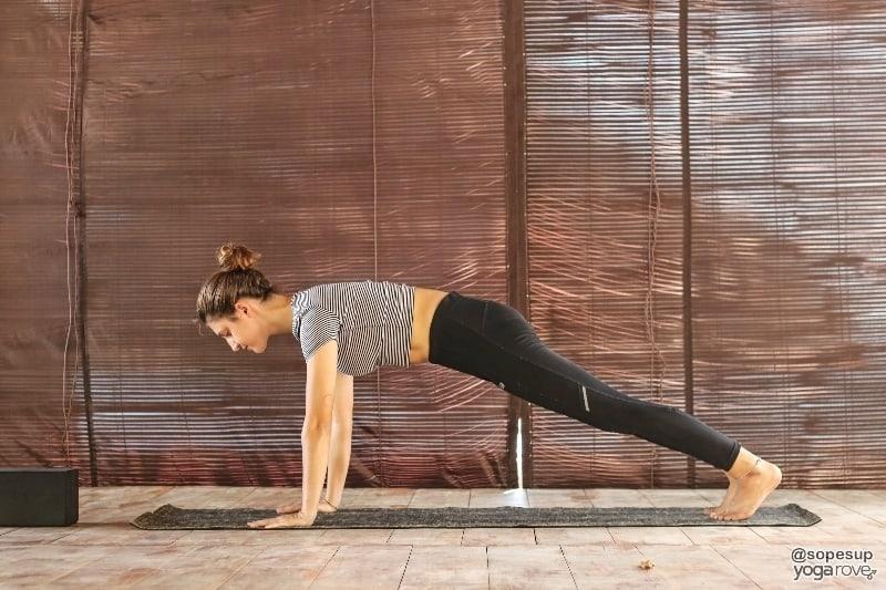 yogi practicing plank to prep for downward dog