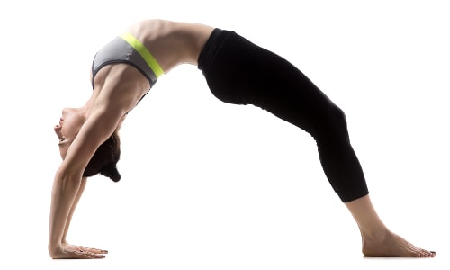 Wheel pose, or Upward Facing Bow, is a great yoga pose to build arm strength. It may look advanced, but there are simple modifications you can do to build up to it.