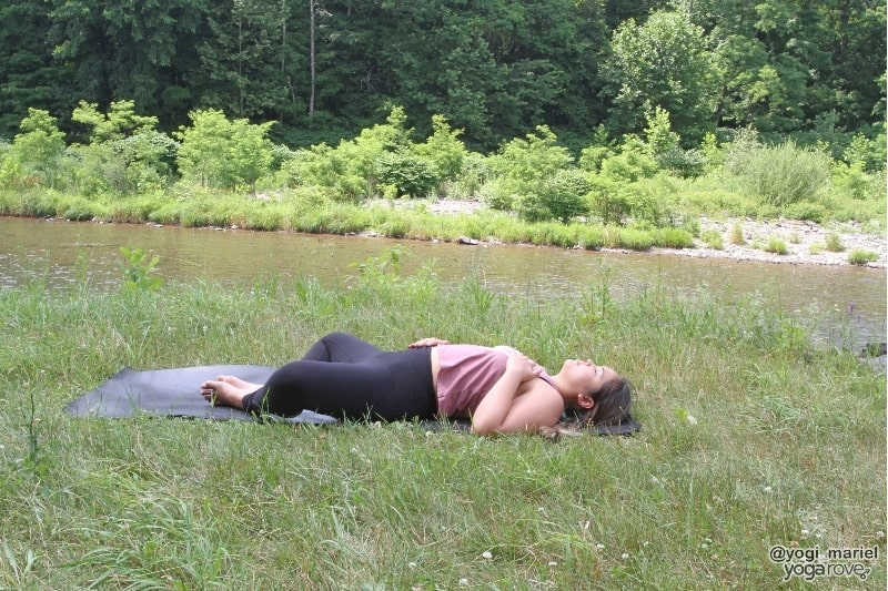 yogi practicing about reclined bound angle in sweaty yoga practice