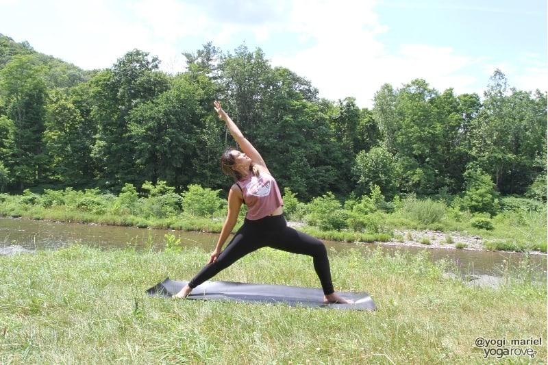 yogi practicing reverse warrior in sweaty yoga practice