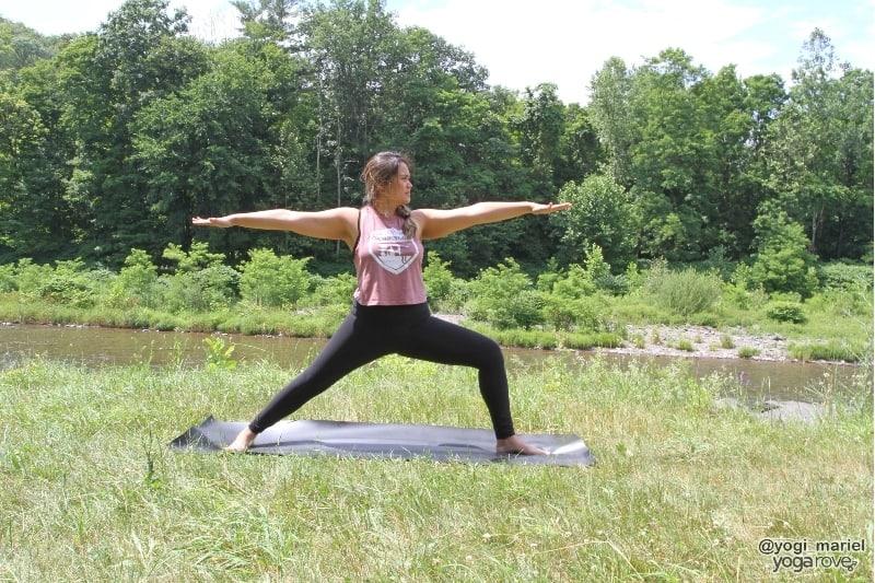 yogi practicing warrior II in sweaty yoga practice