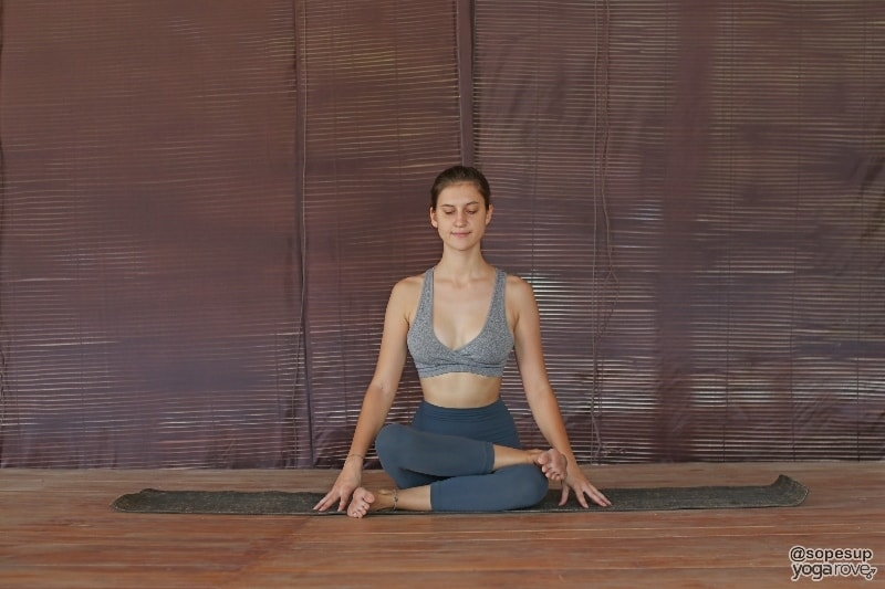 yoga student practicing firelog poses- seated yoga pose.