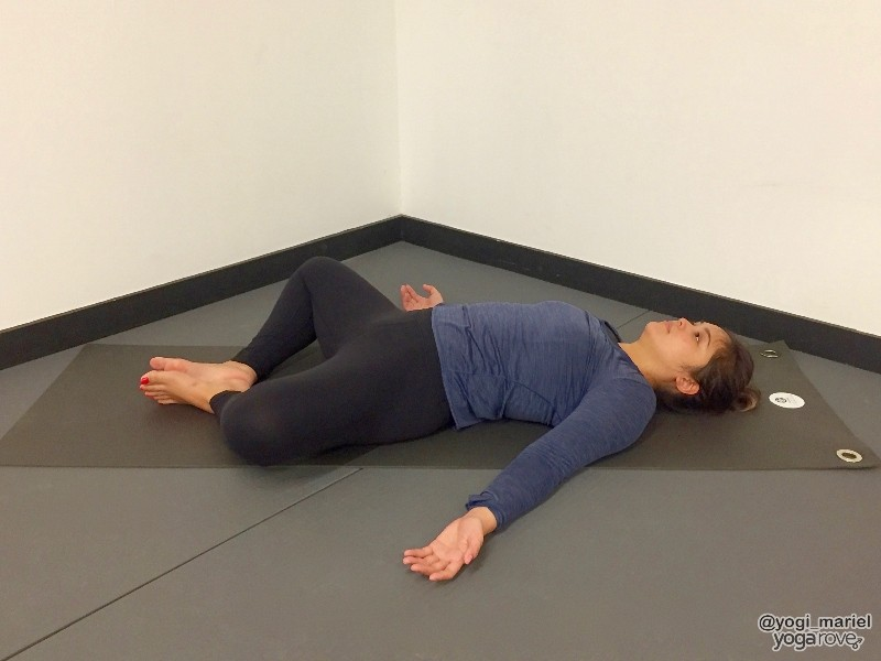 Yogi practicing reclined bound angle pose for sore muscles.