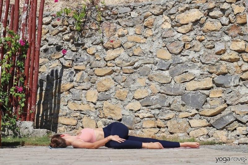 beginner yogi practicing supine spinal twist