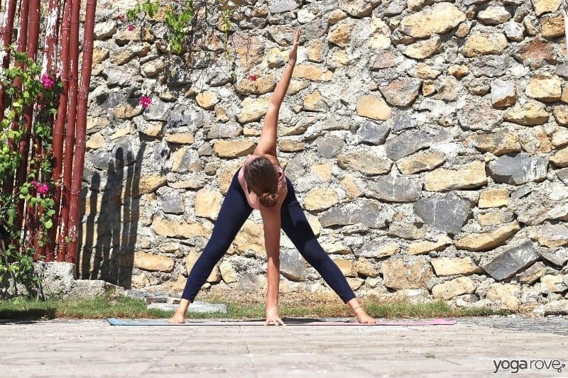 yogi practicing twisted wide legged fold