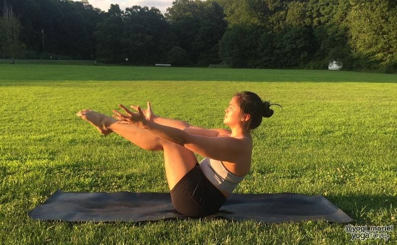 yogi practicing boat pose in hatha yoga
