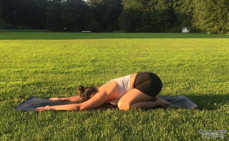 yogi practicing child's pose in hatha yoga