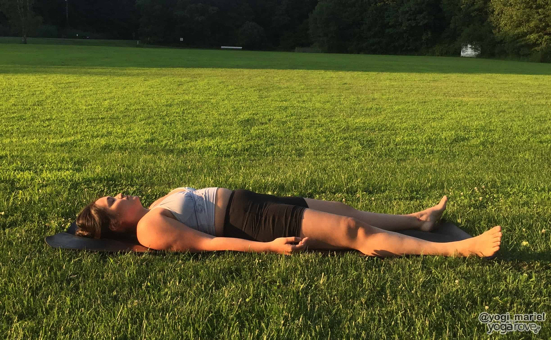 yogi practicing savasana pose in hatha yoga
