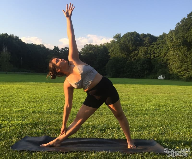yogi practicing triangle pose in hatha yoga