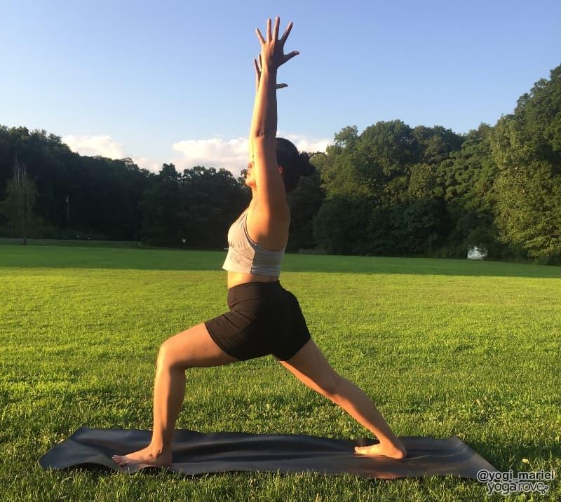 yogi practicing warrior I pose in hatha yoga