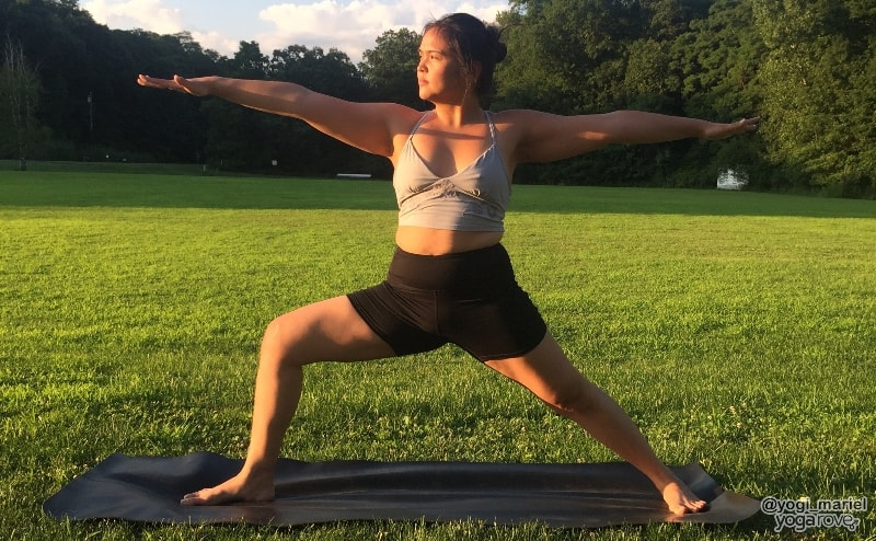 yogi practicing warrior II pose in hatha yoga