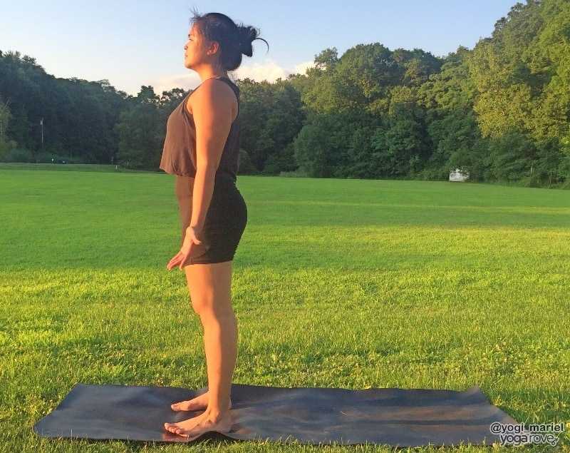 yogi practicing mountain pose to prep for chair pose