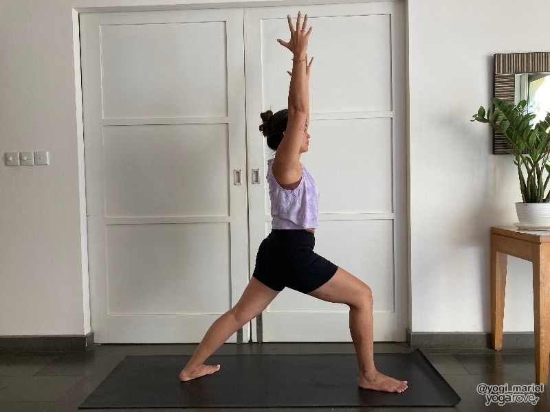 Yogi practicing Warrior 1