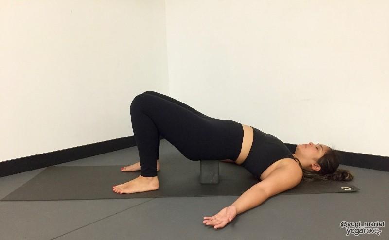yogi practicing bridge pose in balance and stability routine