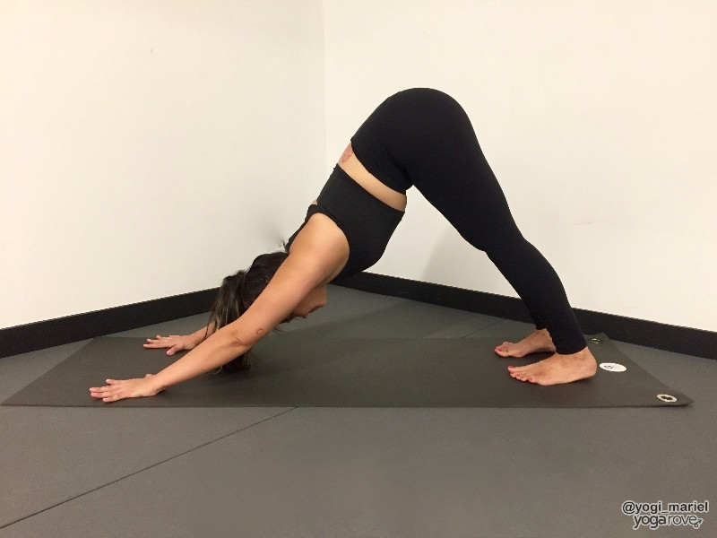 yogi practicing down dog for balance and stability routine