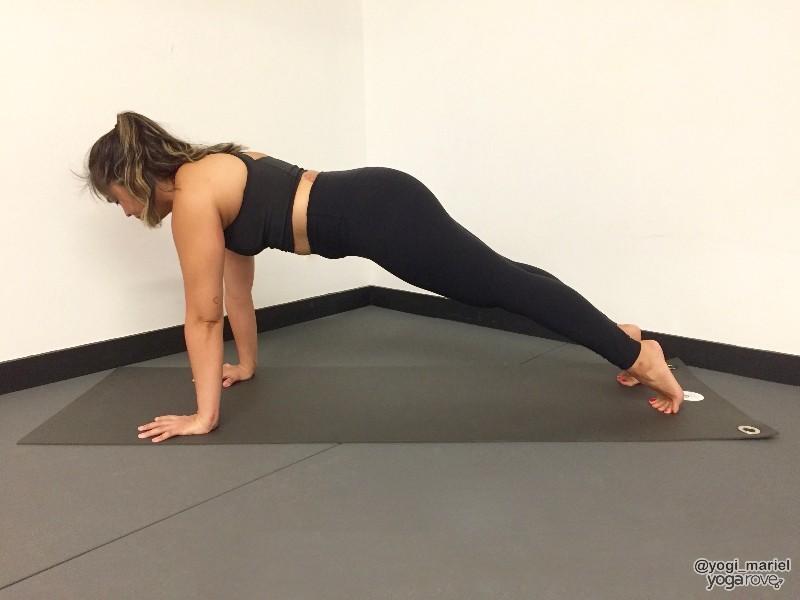 yogi practicing plank pose balance and stability