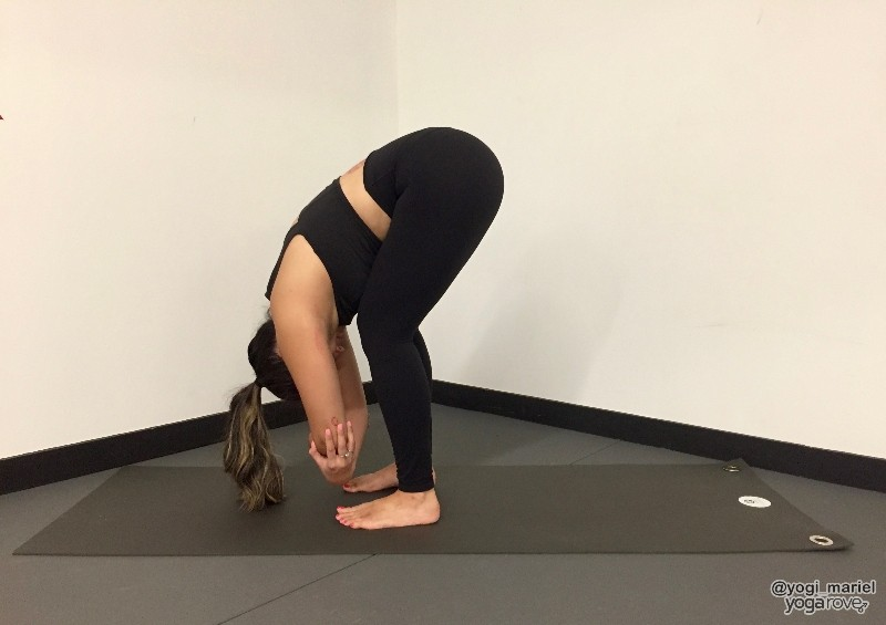 yogi practicing ragdoll pose for balance and stability