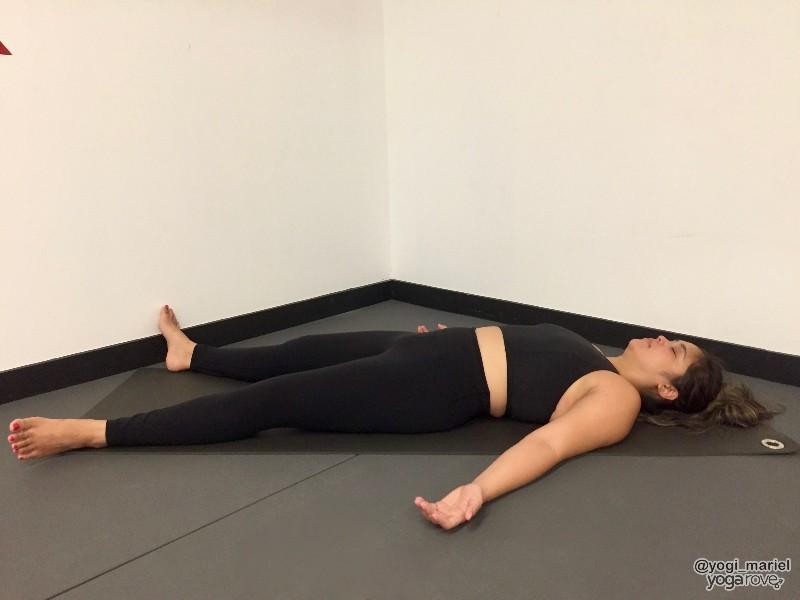yogi practicing savasana in balance and stability routine